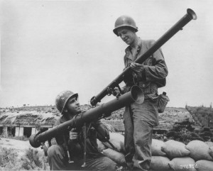 Soldiers compare the 3.5 inch and 2.5 inch bazookas