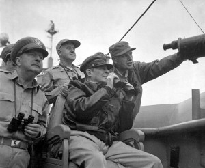 MacArthur observing the landing, Major General Edward Almond is standing on his left