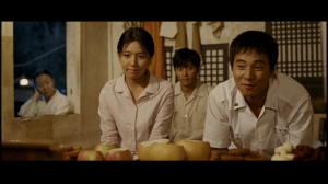 Young-shin and Lee Jin-seok in the front, Jin-tae in the rear, and their mother is at the window
