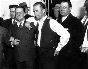 Dillinger posing for pictures with the state prosecutor.